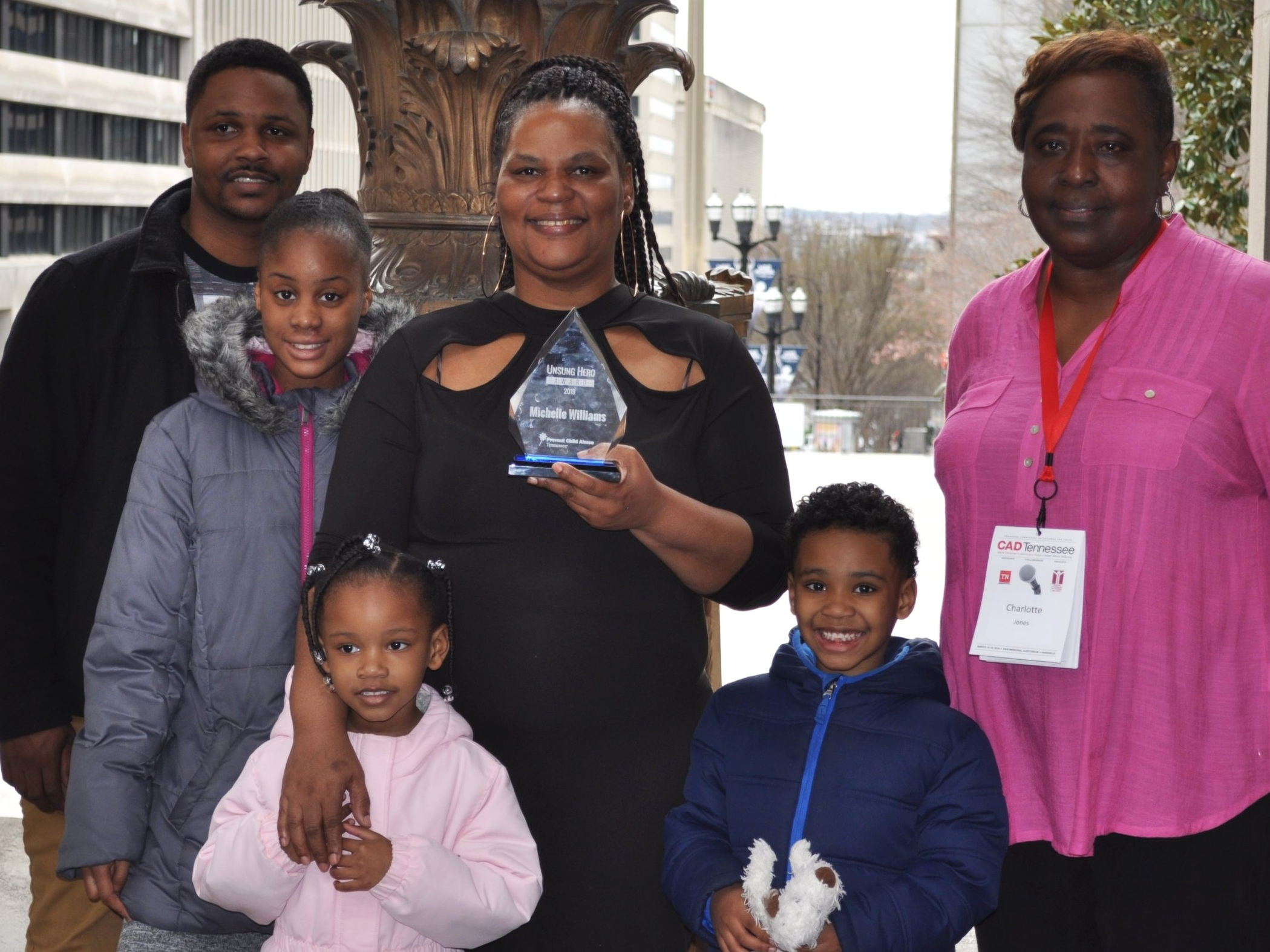 Michelle+Williams+with+her+family+and+a+representative+from+the+Memphis+Child+Advocacy+Center.jpg