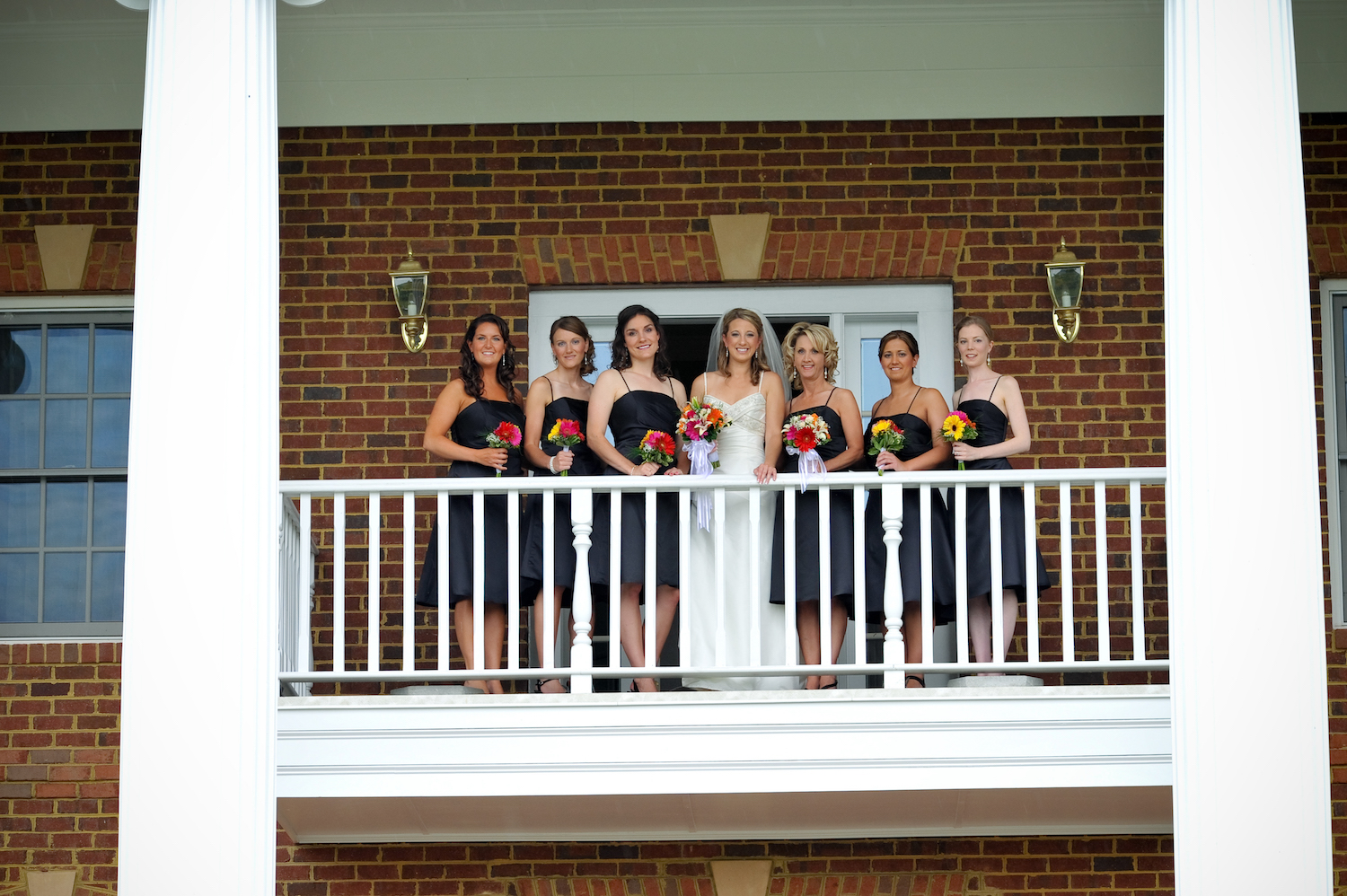 front-rose-hill-bridal-party-on-balcony.jpg
