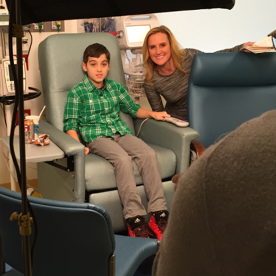 Behind the scenes shot of Cooper filming about the Peanut Patch for CBS with Mary Kay Kleist