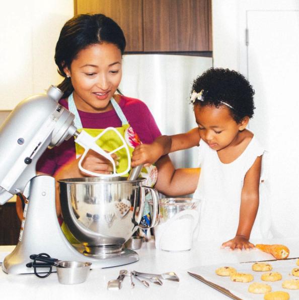 Denise Woodard and daughter Vivienne baking