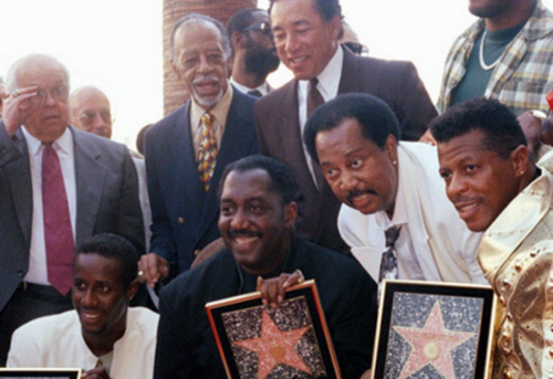 Starring in Hollywood, the Temptations: from left, Theo Peoples, Otis Williams, Melvin Franklin and Ali-Ollie Woodson. Behind them are Smokey Robinson and, to his right, Cholly Atkins (photo: AP)