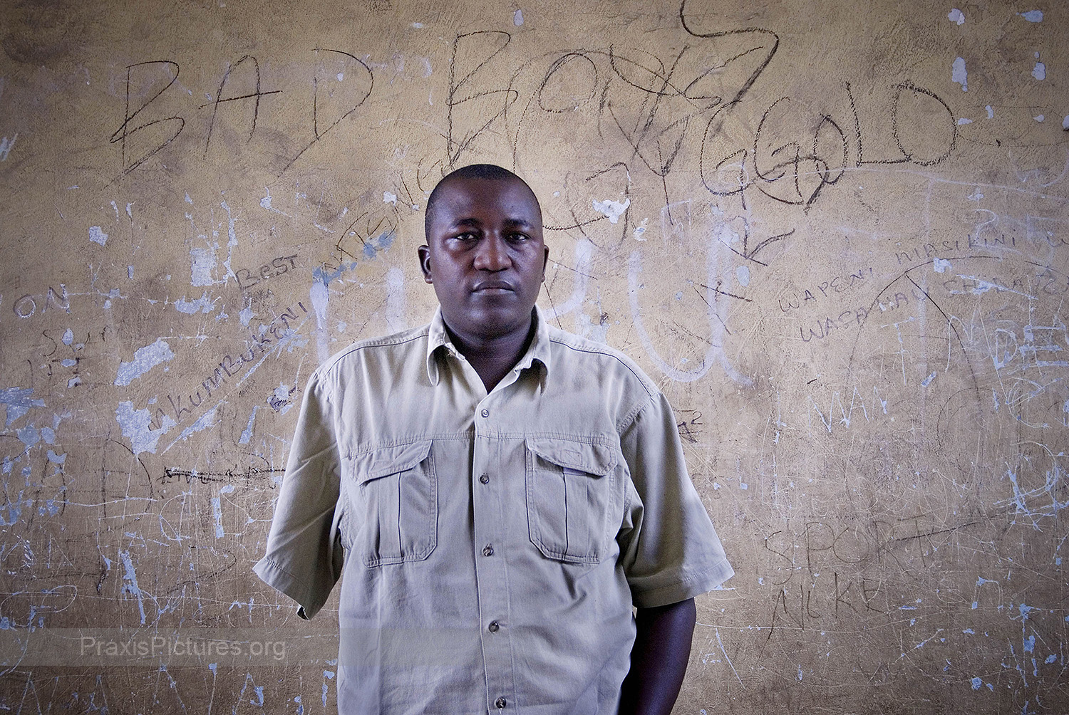 """DEUS - Deus had worked in the Bulyanhulu Gold Mine, in Tanzania, as a supervisor for five years when he was in an accident in 2006 where a big rock fell on him. His coworkers pulled him away in time to save his life before more rocks came falling down. The Bulyanhulu Gold Mine boasts  """"one of the most up-to-date and well-equipped and staffed medical clinics in Tanzania.""""  Yet, despite these claims, Deus had to be flown one thousand kilometers away to Dar es Salaam, waiting for a total of 18 hours before receiving any treatment. His arm eventually had to be amputated, but he vividly remembers the doctor telling him that if he had received treatment earlier it would have been a very simple procedure to save his arm which any trained doctor would have been able to perform. Continuous labor disputes have been a recurring theme at the Bulyanhulu Gold Mine with workers complaining,  """"there is no humanity in the way they [treat] us! They make us promises while we are of use to them. But then, if we become sick, or old, or start to complain about our rights, then they just spit us out like a chewing gum that has lost its flavor."""""""