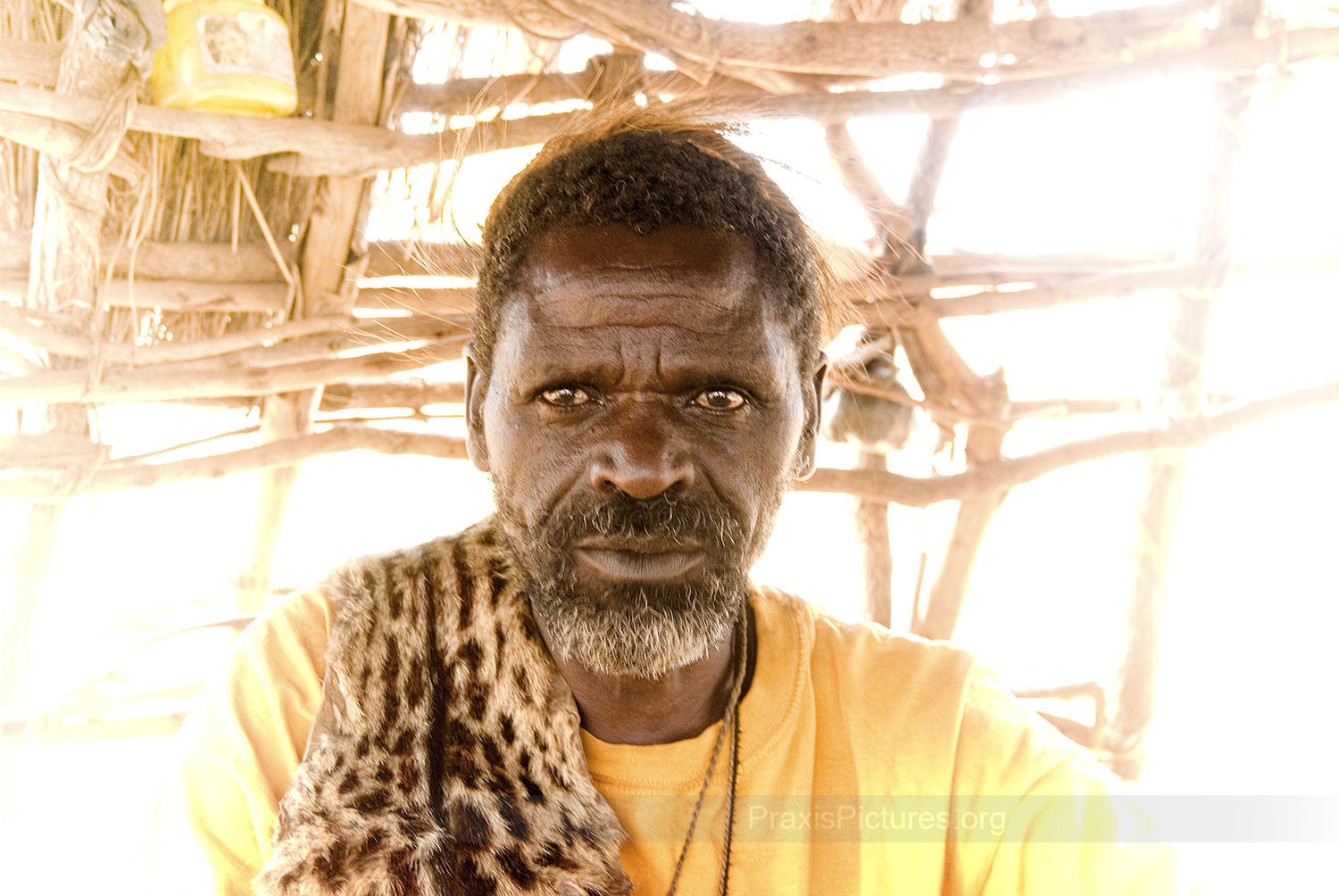 DEOGRATIOS - Deogratios is the traditional witchdoctor, or medicine man, of the indigenous community. He was among the thousands of people who were evicted to make way for the Bulynhulu Gold Mine in Tanzania. He remembers being forced from his home by heavily armed paramilitary forces only one day after the Minister of Minerals and Energy had issued an order giving the Bulyanhulu residents one month to vacate the area. Deogratios and his family had nowhere to go, so for two months after being forced from their home they were living in the bush. During this time his wife became ill. But with their home destroyed, and without access to his medicines, the healer could do nothing as he sat and watched his wife die.