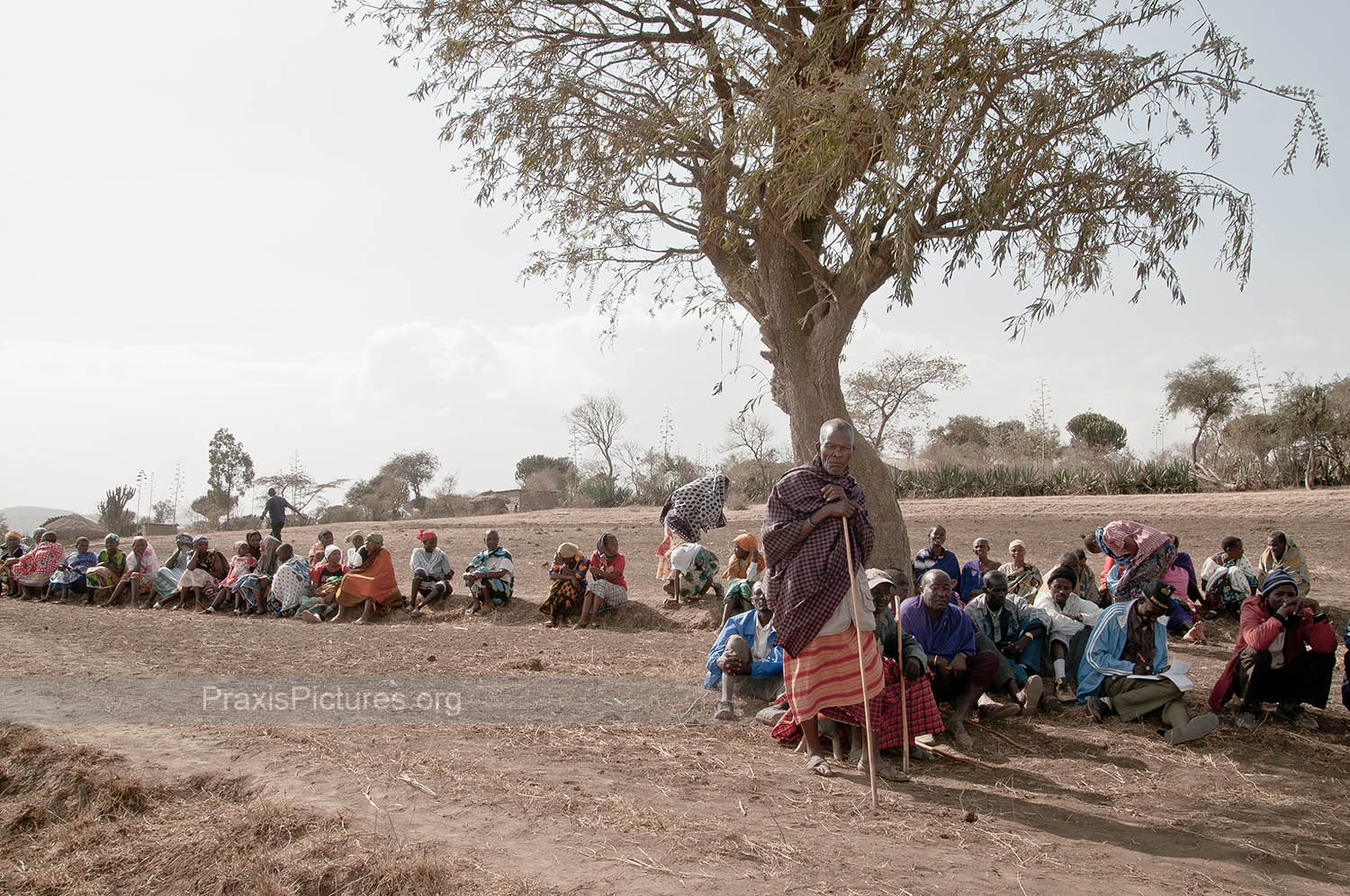 COMMUNITY OF NGORBOB - The community of Ngorbob gathers to explain their situation, surrounded by their now barren farmlands.