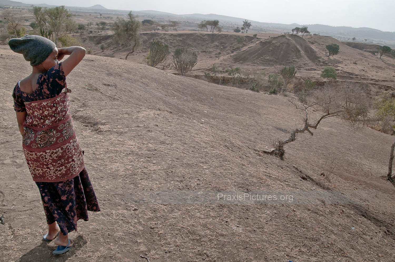 ARID LANDSCAPE - Zawadi looks out at the arid landscape surrounding Ngorbob.