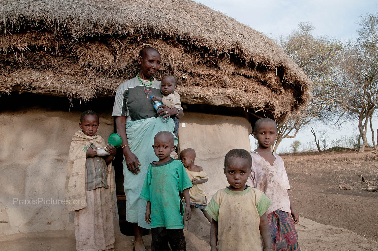 KOKOYA AND GRANDCHILDREN - With the young and able-bodied having to journey farther and farther to find water and employment, the children and elderly are left behind in the village.