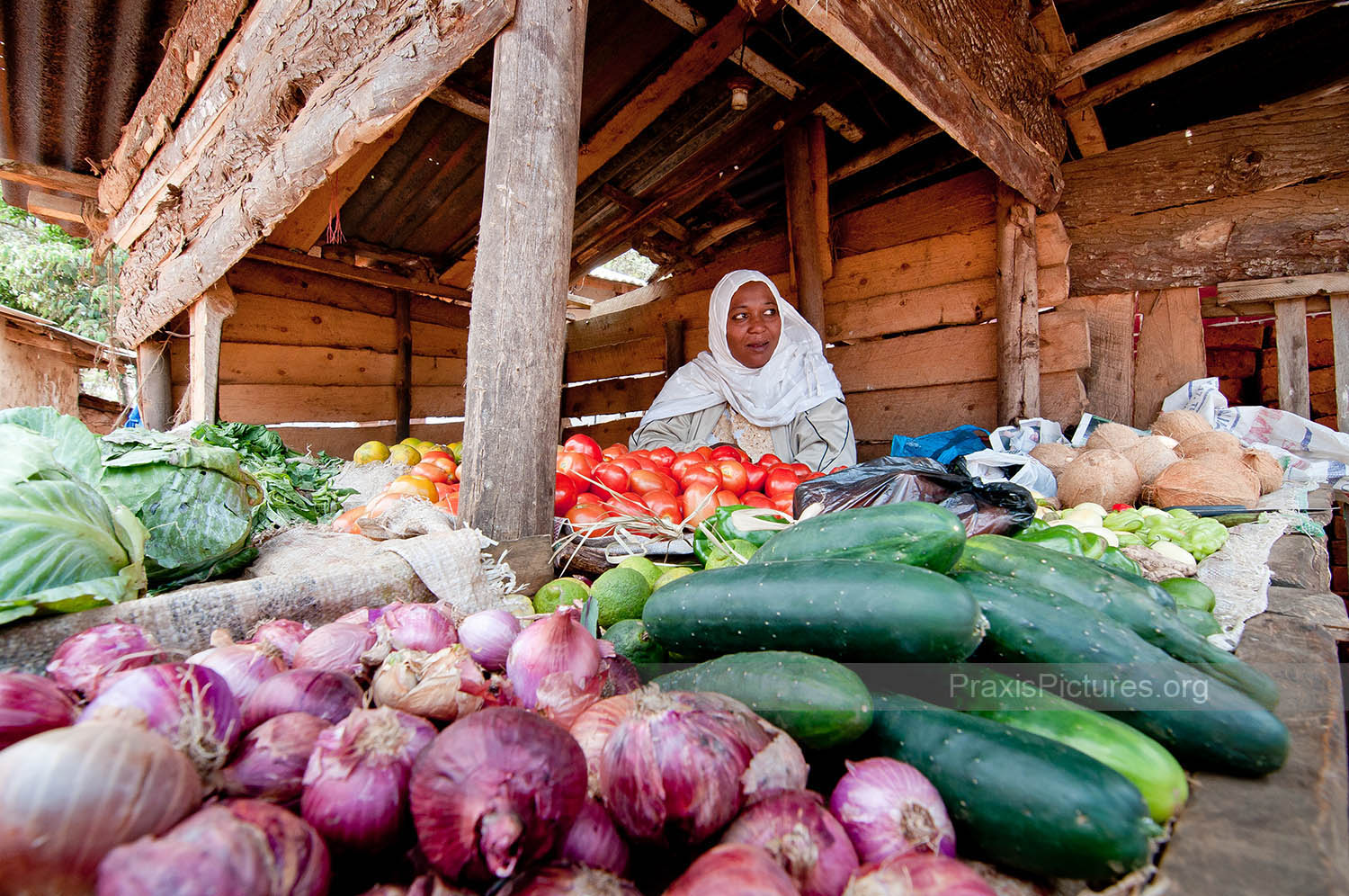 FARAHA - Faraha sells vegetables in the market in Lushoto thanks to a small start-up loan from her local VICOBA group.