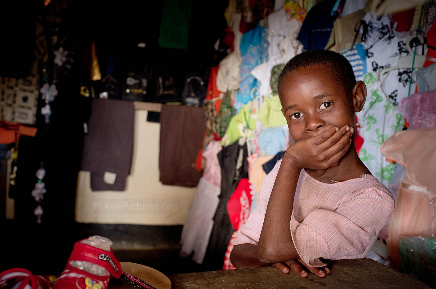 DEBORAH - Deborah's mother joined a VICOBA group in Mugusu in order to invest in her clothing shop. Because business has been going well for Deborah's mother, Deborah is now going to school and getting an education.