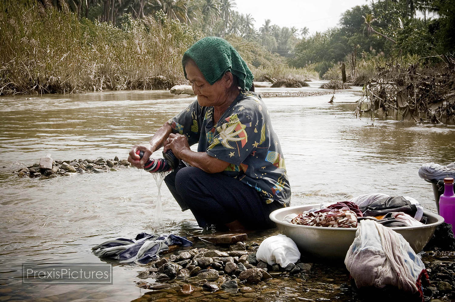 Remy washes her laundry in the poisoned Mogpog River in Marinduque. With the two main rivers on the small island now biologically dead and containing dangerous levels of toxic chemicals, many of the residents of the island are left with no safe water supply to rely on.