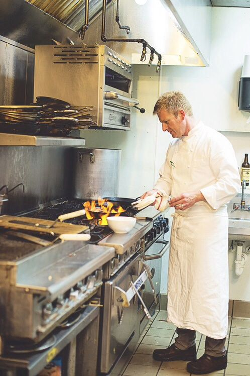 Chef-Owner Lynn Pritchard at the stoves of Table 128.