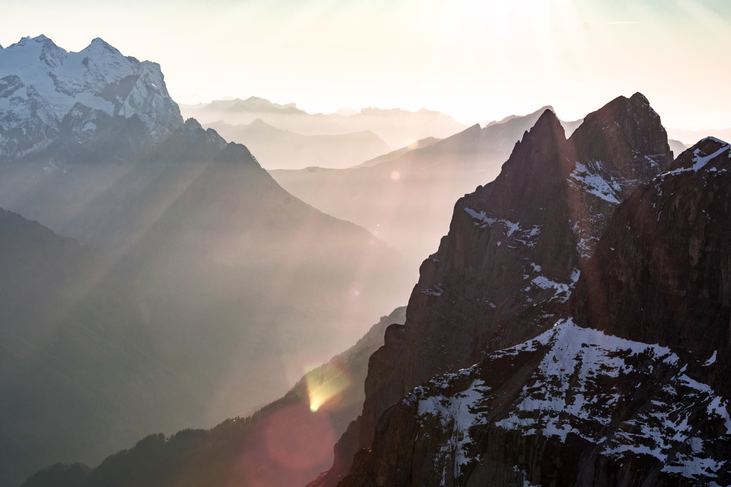 Light rays streaming through the Alps in Engelberg.
