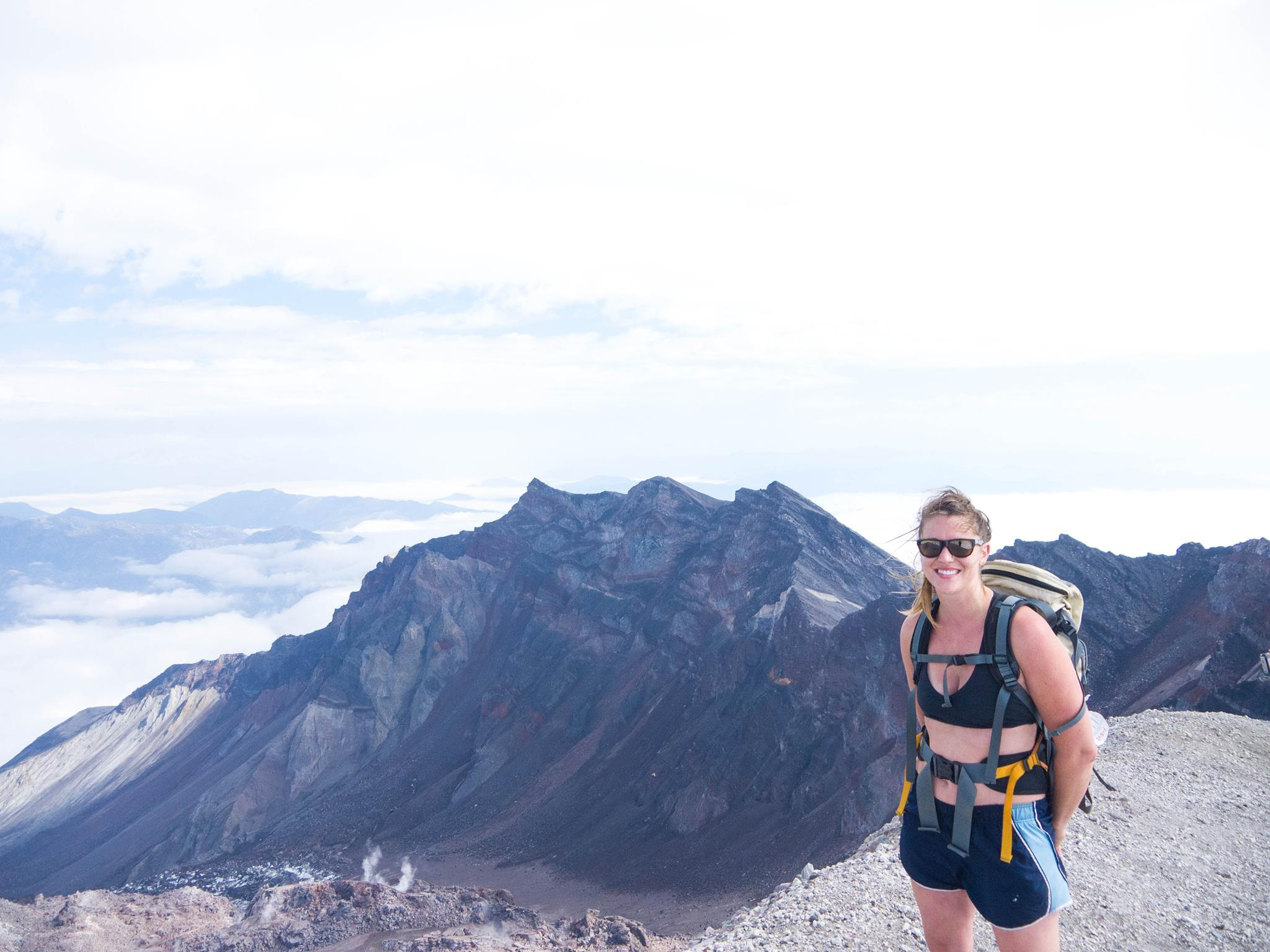 Yes, I am on the summit of this volcano in a sports bra and bare feet. No, I don't need any assistance but I will accept Nutella donations.  Photo:  Ryuhei Yokokawa