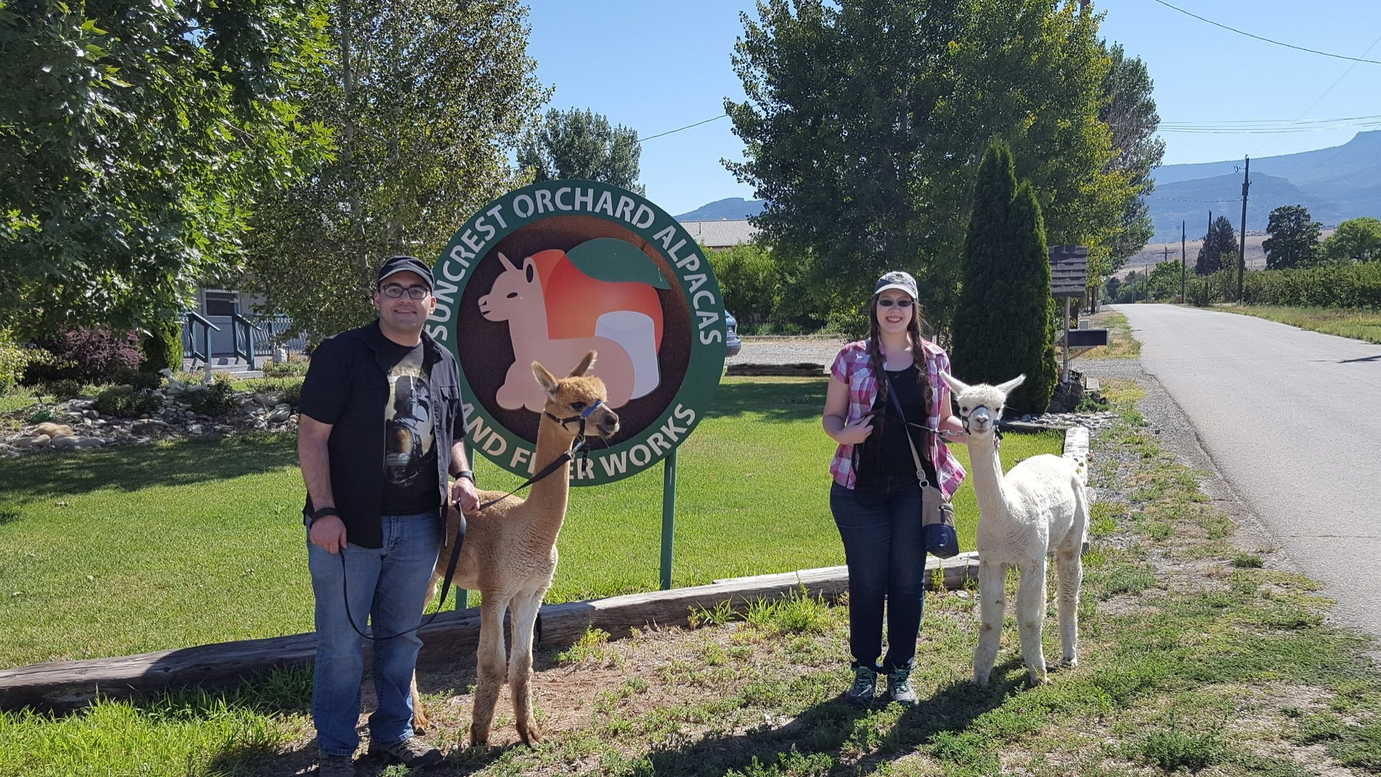 FROM LEFT TO RIGHT:  Jason Rivera, Owner of DARK MOUSE DESIGNS, LLC; Sweet adorable friendly alpaca; Echo Rivera, Owner of CREATIVE RESEARCH COMMUNICATIONS, LLC; Grumpy but still adorable alpaca.