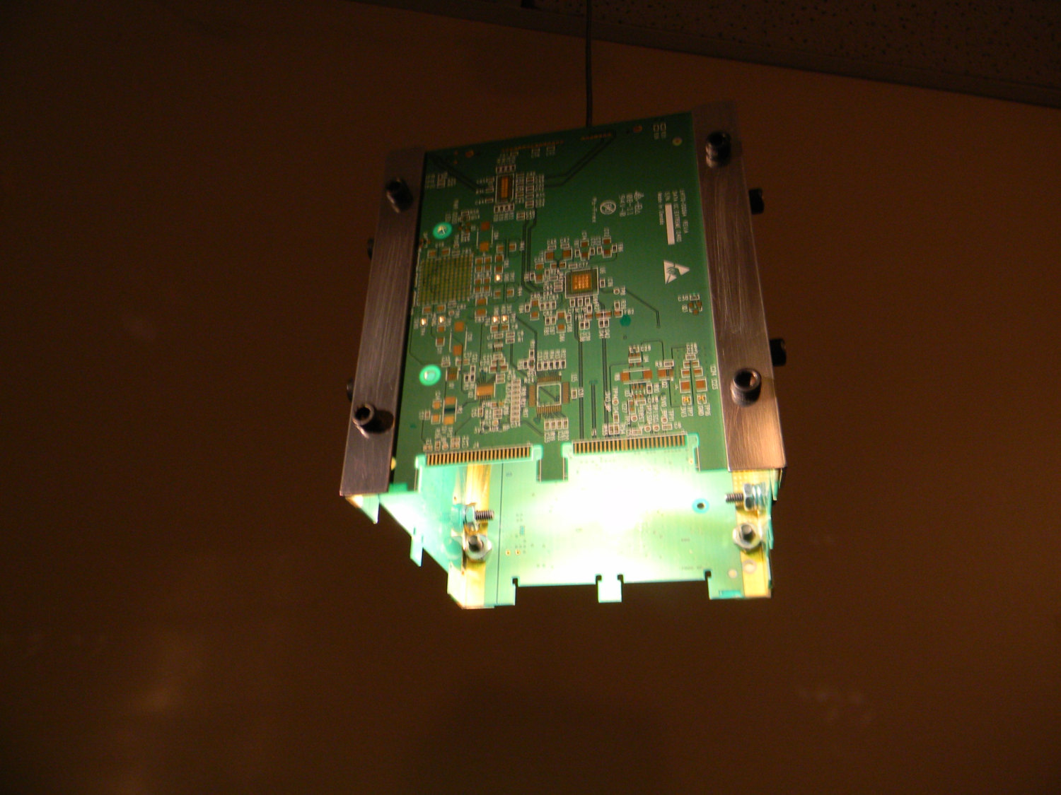 Creative upcycling  artist and customer,  Albin Wandeler  has an eye for the unconventional and handcrafted this beautiful circuit board pendant lamp, making brilliant use out of what otherwise would have been destined for the shredder.