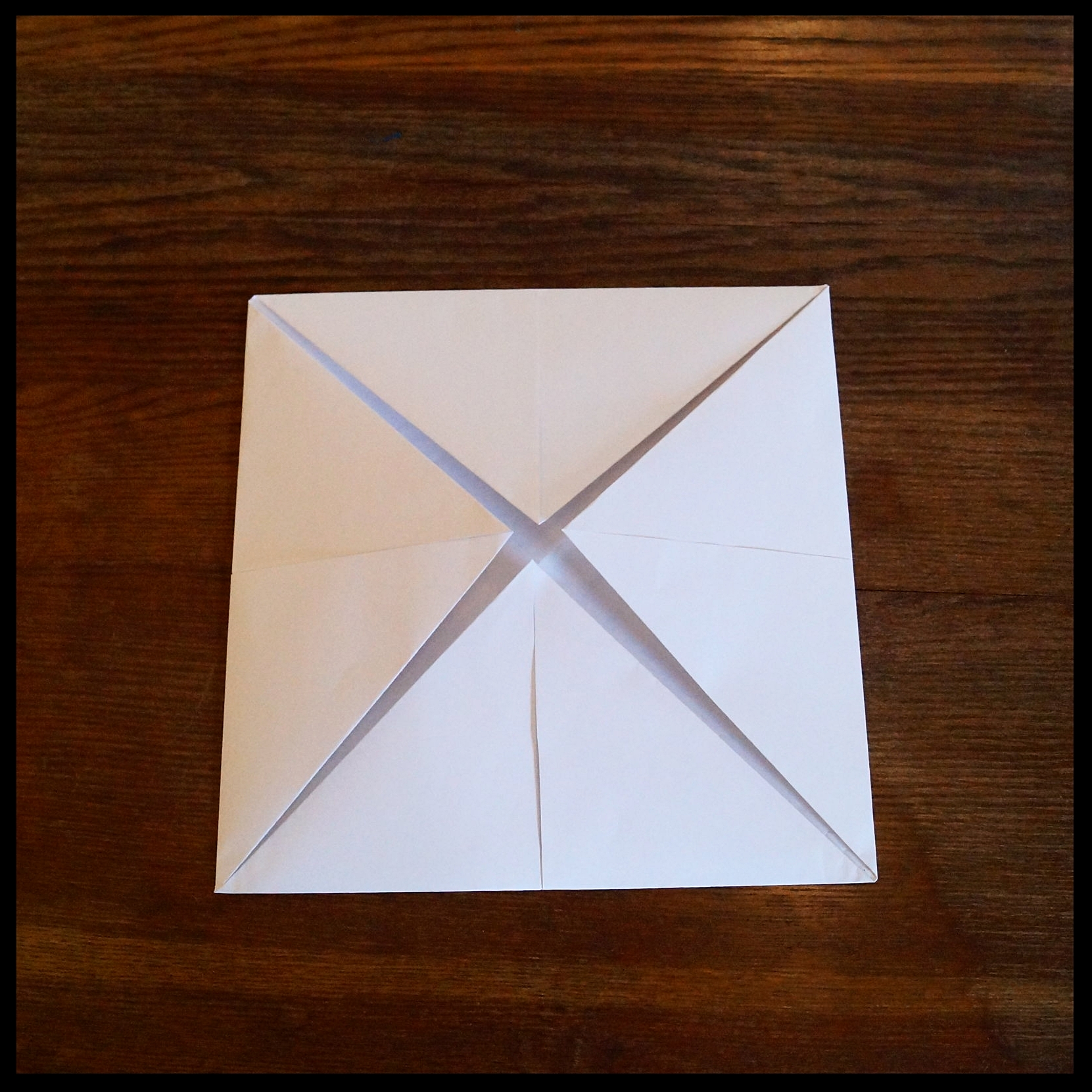 1c. Flip over. Fold each corner into the center again.
