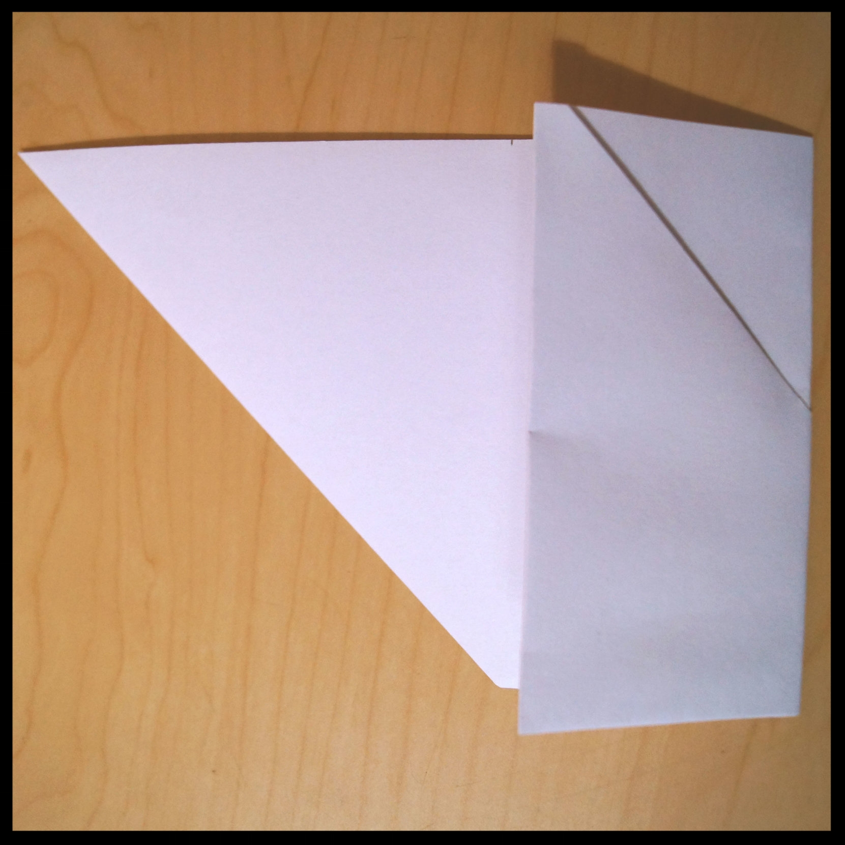 5.       Repeat so the entire rectangular part is folded.
