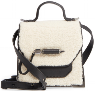Mackage Shearling Crossbody :  What an unexpected and FUN way to use shearling. Even though it's unique, it still is neutral and versatile to match numerous outfits! The simplest Look is transformed with this bag.