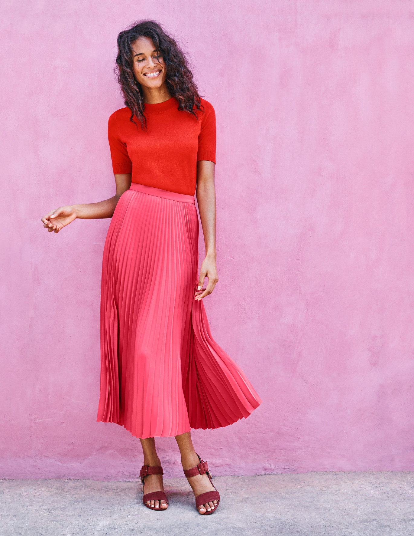"Boden Pleated Skirt  The red/pink color combo is VERY on trend. Don't fear looking like a Valentine's Day card. It super ""in"" and tres chic!"