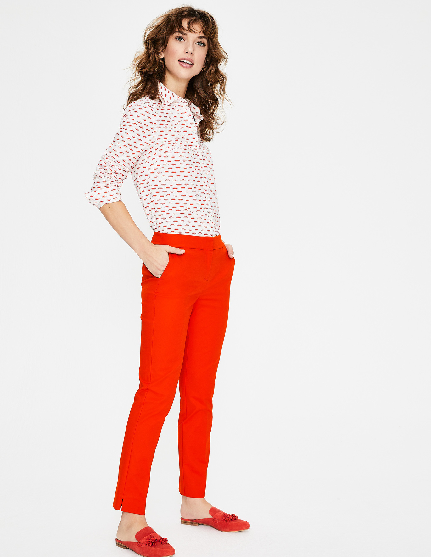 """Boden Richmond Pant  If a red pant is too intimidating for you… perhaps, """"too much"""", you'll want to soften it with subdued pieces like a beige loafer or a denim button down."""
