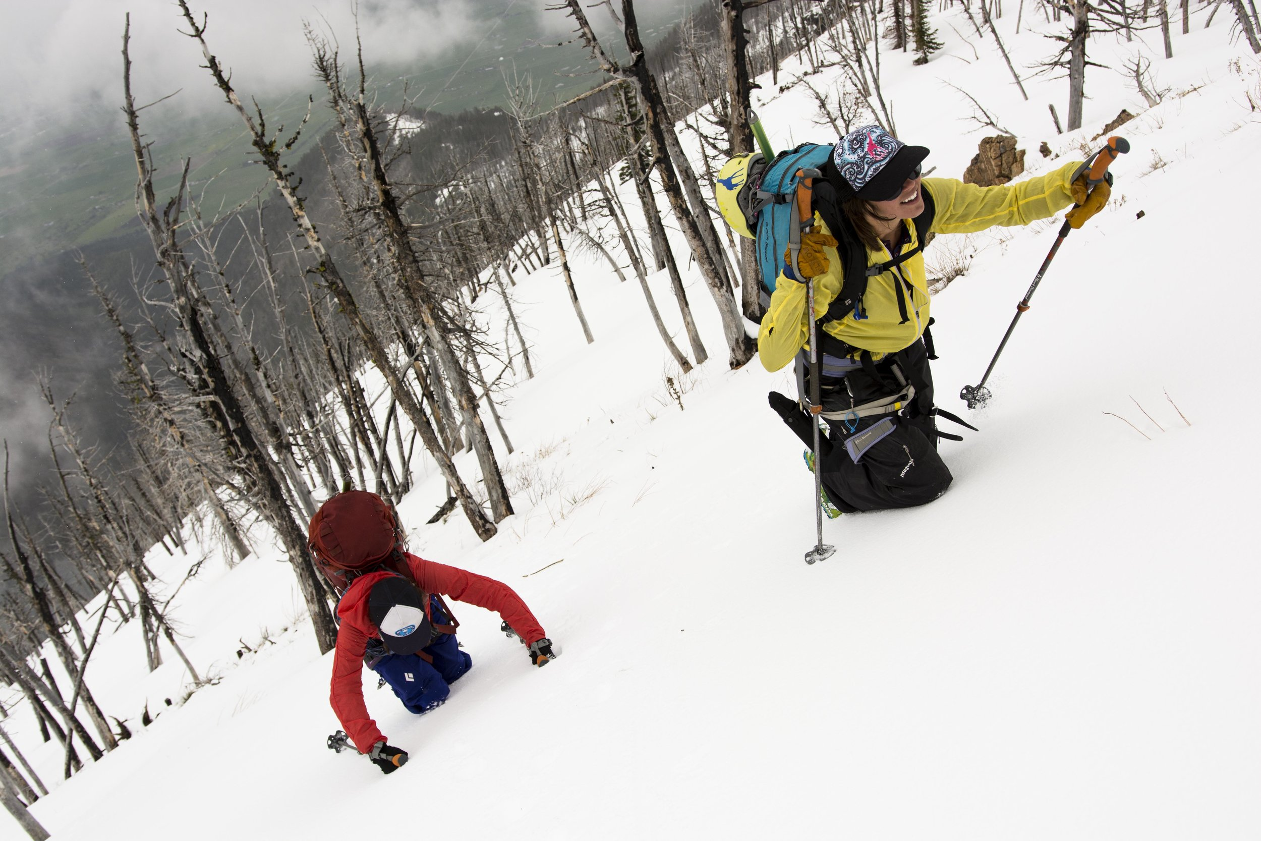 """Steph, left, and Sophie work their way through the awful punch-crust using a unique and innovative technique we dubbed """"The Sophie."""" It involved crawling on all fours up the side of the mountain to prevent your feet from busting through the crust."""
