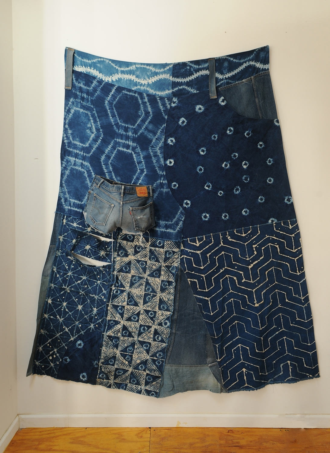 Big Jean Skirt, or The Rich Soul receives blue crystals sprinkled down upon her head.