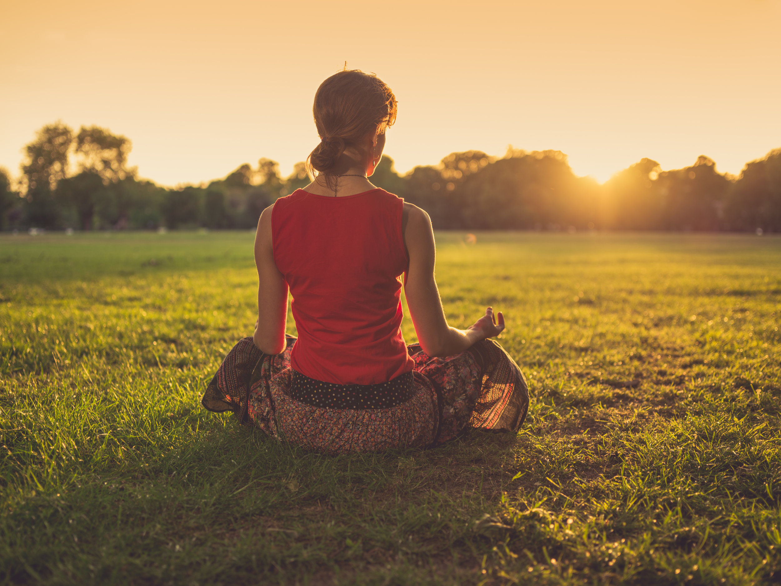 bigstock-Woman-Meditating-In-Park-At-Su-91459358.jpg