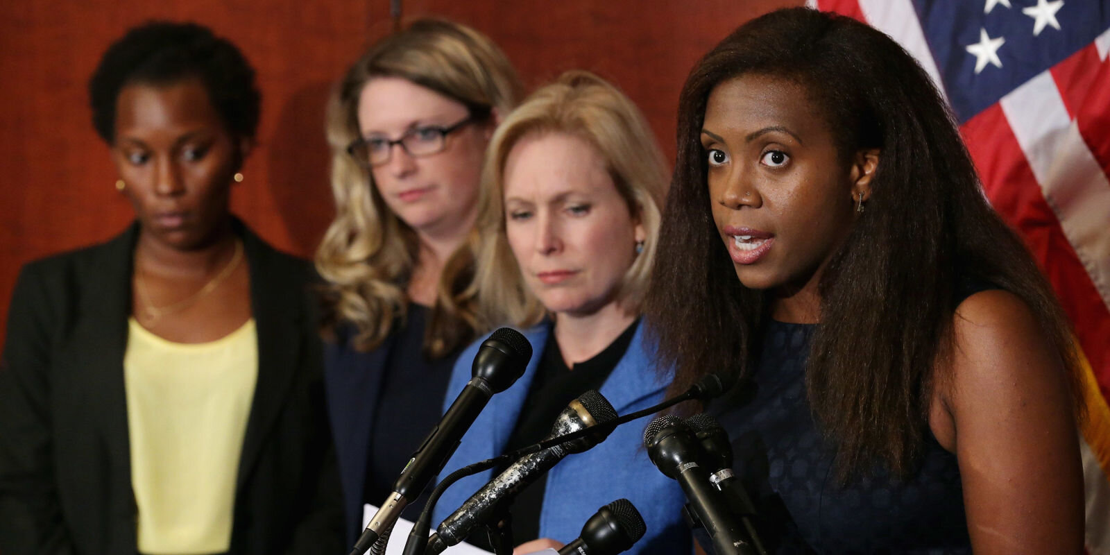 Speaking next to Sen. Kirsten Gillibrand on Capitol Hill in 2015. Photo by Getty. Images