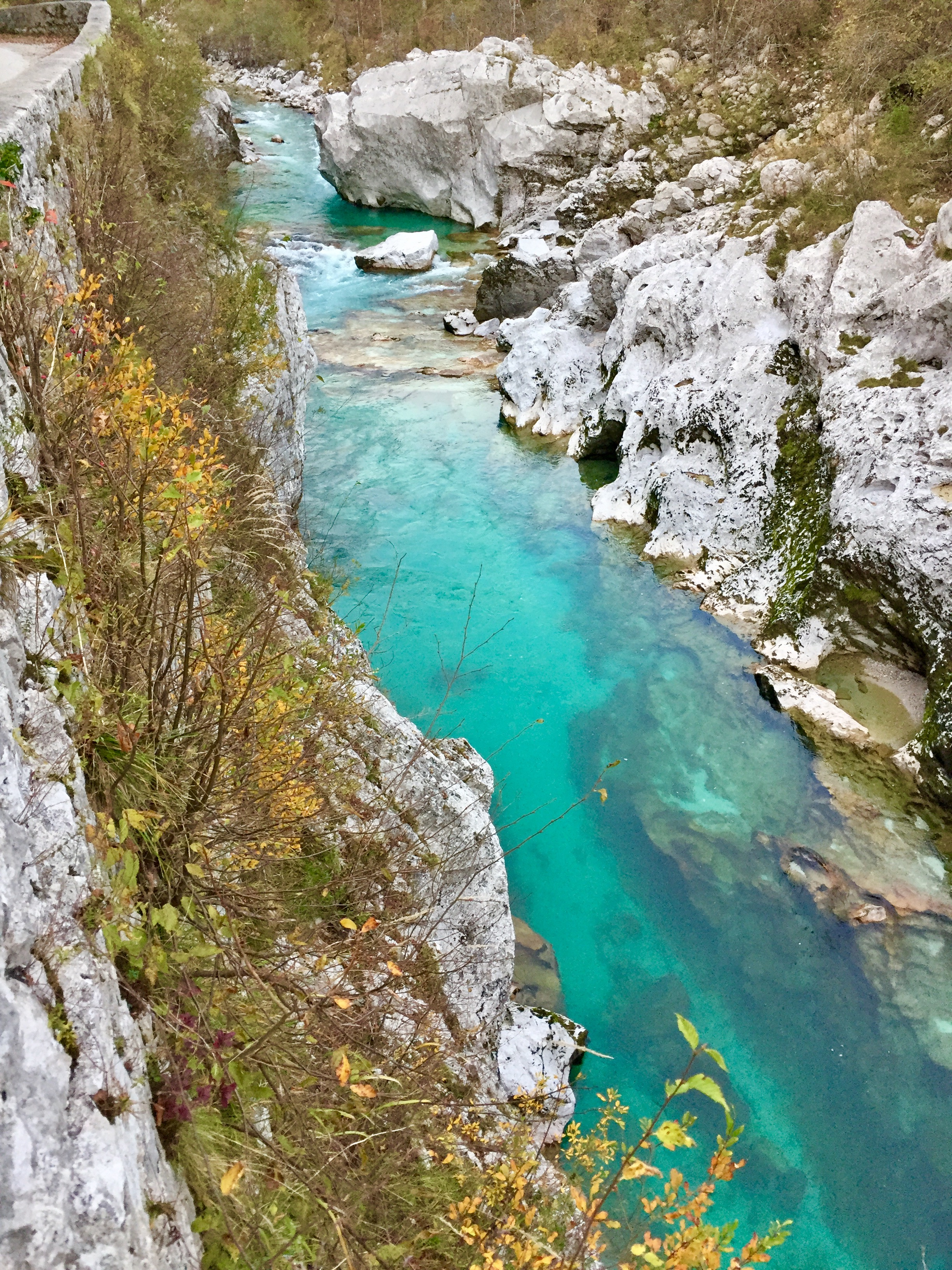 The Soča River is a vibrant blue-green