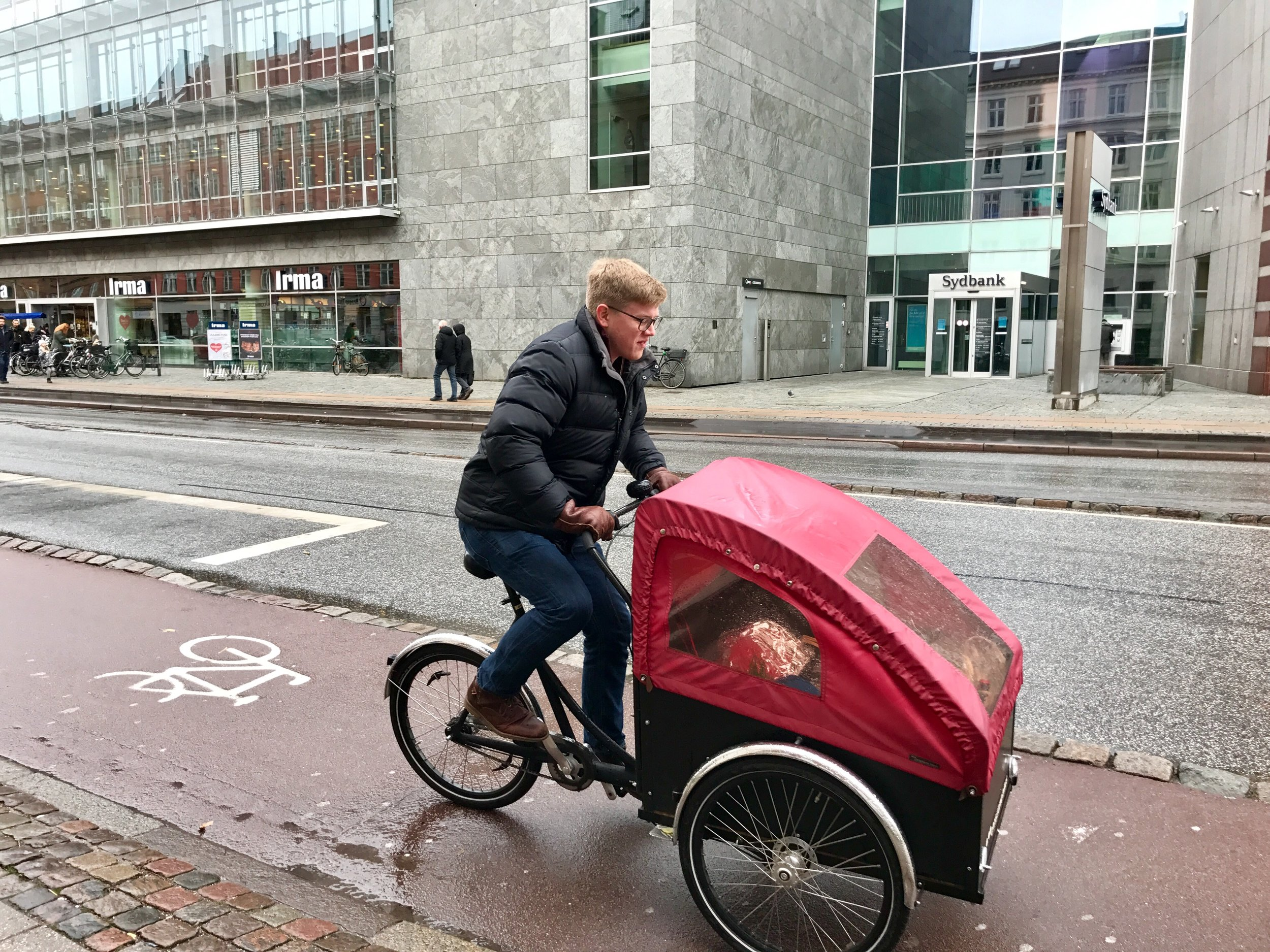 Sam transporting the Thanksgiving meal, including a pre-ordered turkey to the party on a Christiania bike