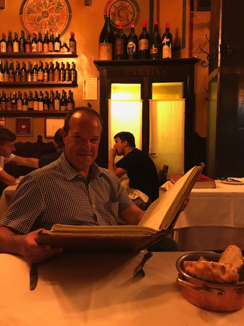 Greg with an amazing wine list at Verona's   Antica Bottega del Vino