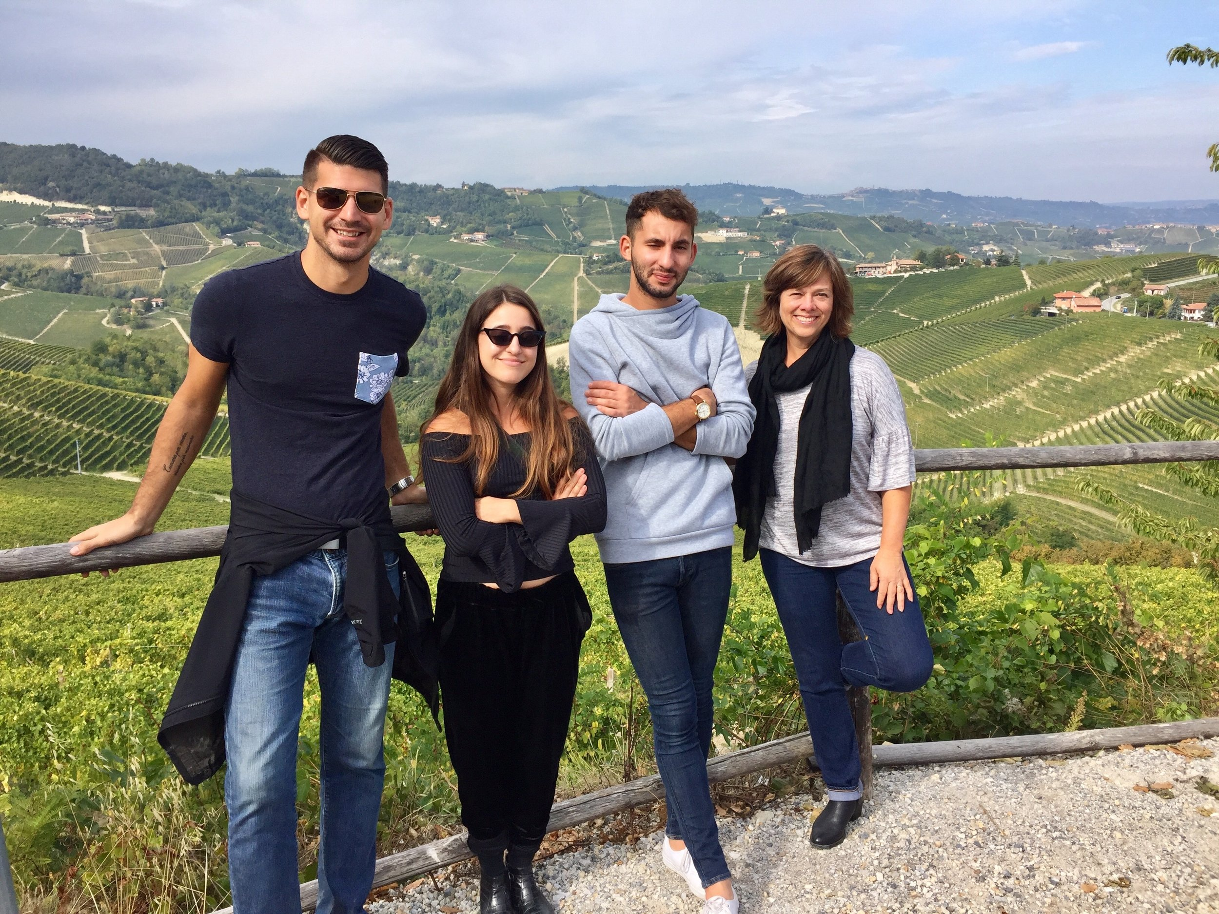 Nieko, Idan, Jonah, and Betsy touring the Barolo region with the Serralunga hills covered in vines