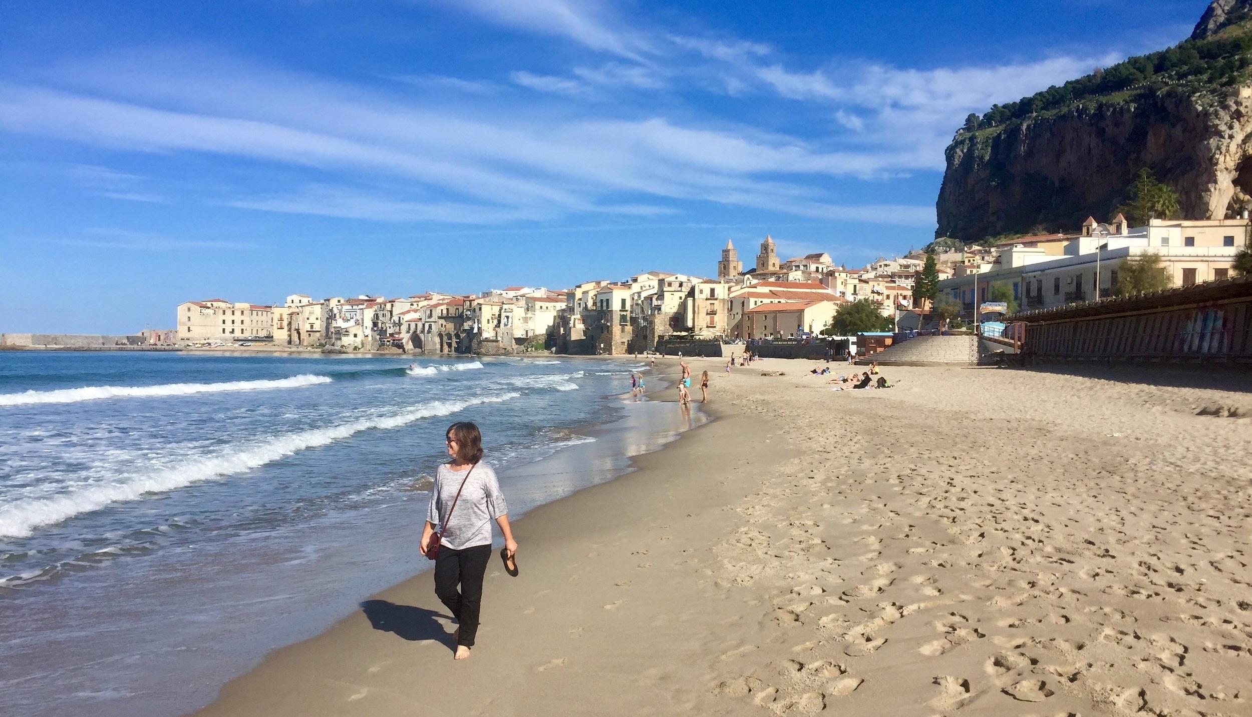 Walking the beach at Cefalu, Sicily