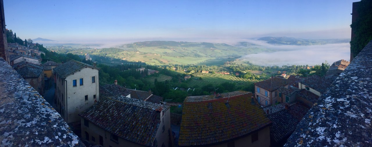 Morning in Montepulciano with fog sitting in the valleys below