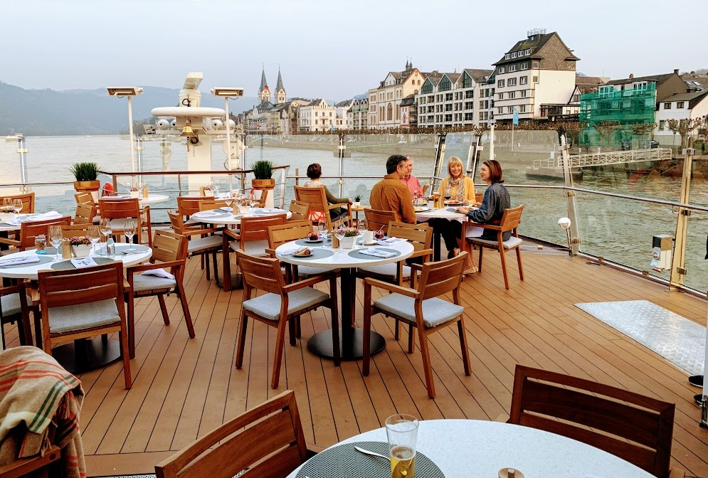 Viking River Cruises allow you to enjoy a meal with fantastic views! (Betsy is the one in the rocking chair enjoying the stunning views)