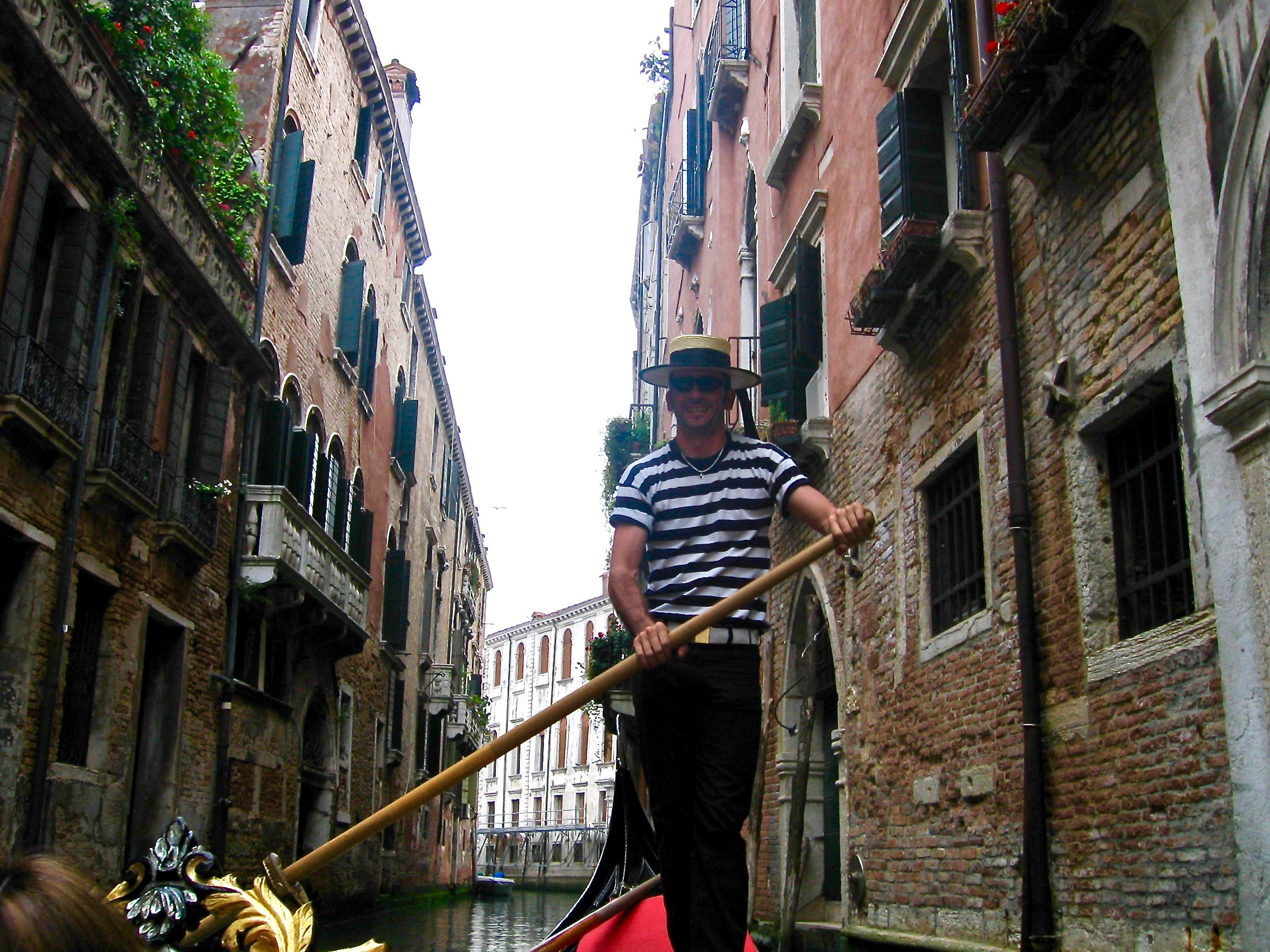 Our Gondolier on the one of the smaller canals in Venice