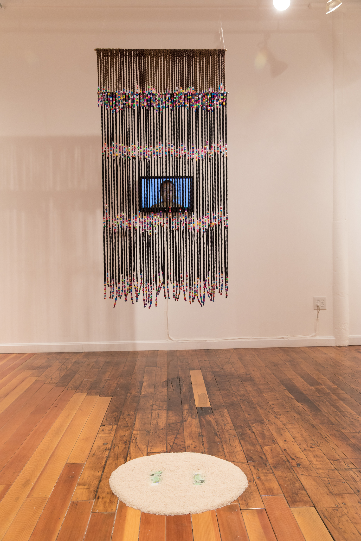 Dana Davenport,   Box Braid Curtain , 2016, synthetic kabkalon hair, beads;  Learning Korean, 2015,  video;  One Hundred Fifty Thousand Won , 2017, rice and Korean won.