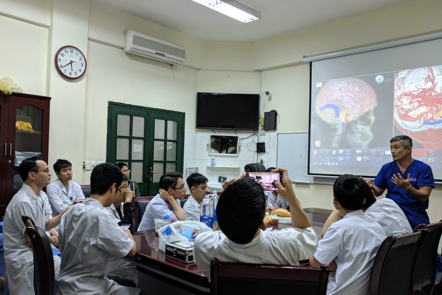 Dr. Jean lecturing neurosurgical residents in Hanoi, Vietnam