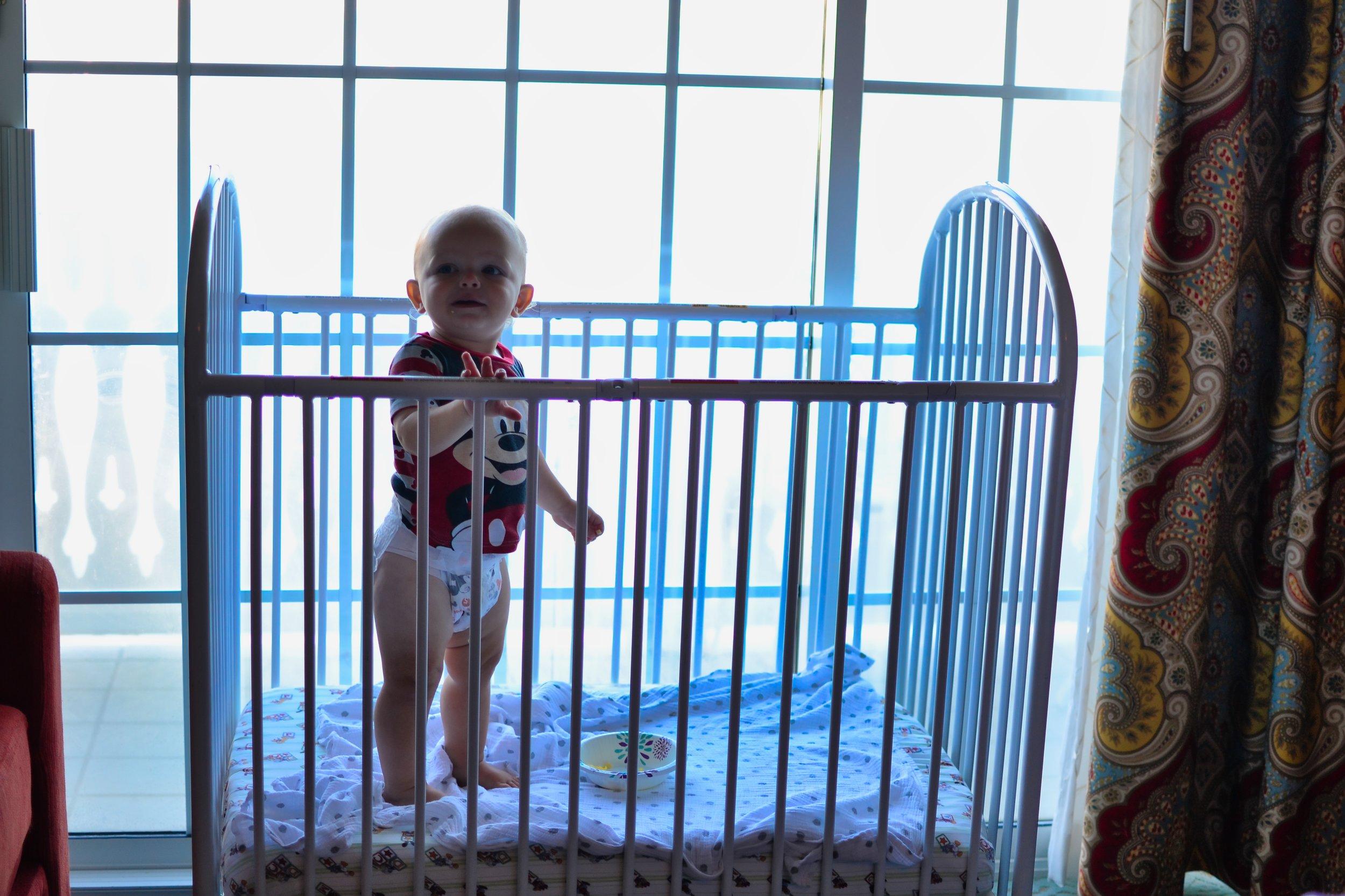 toddler in crib.jpeg