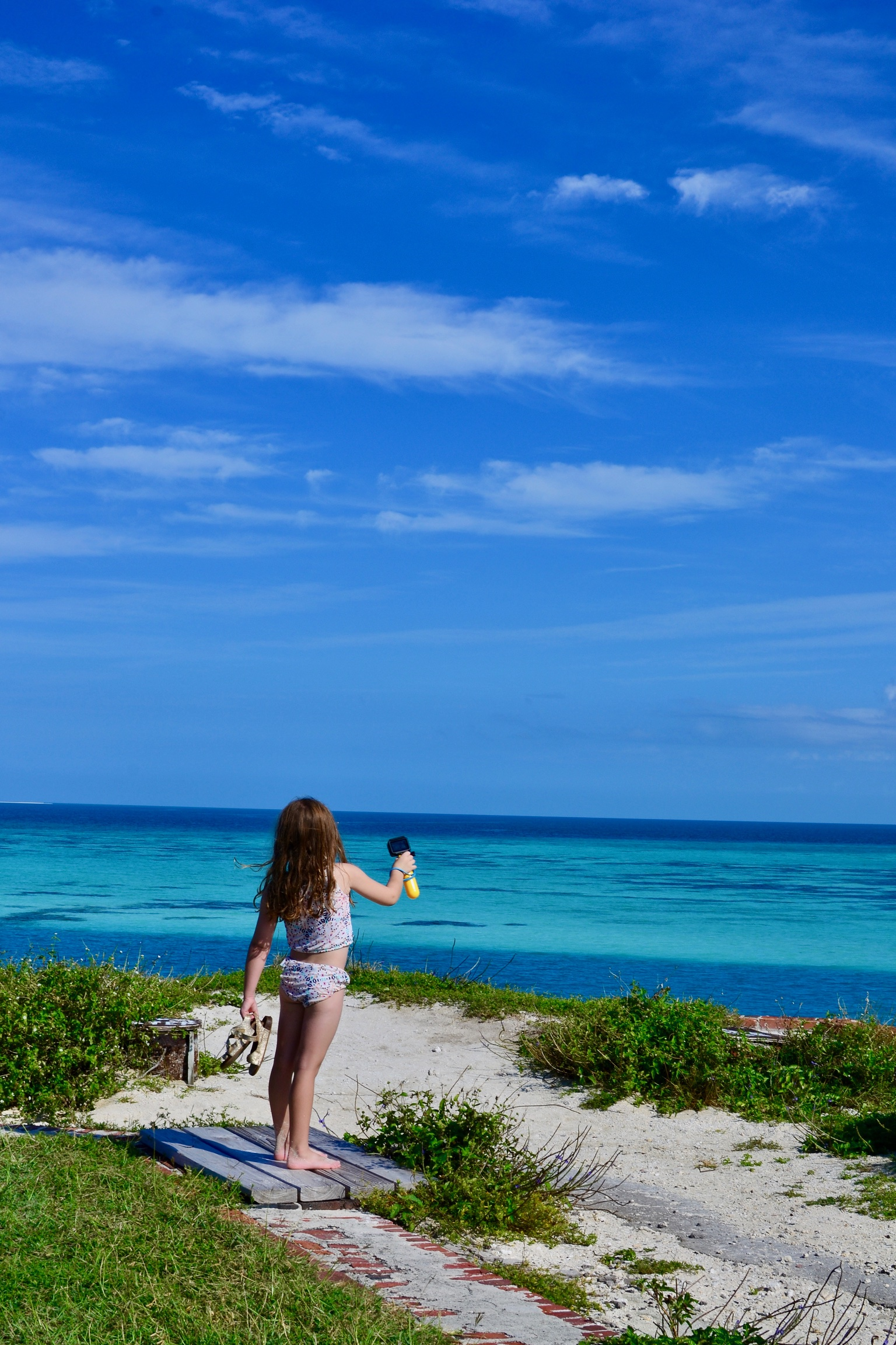 My daughter using our GoPro Hero to take photos and videos in the Dry Tortugas