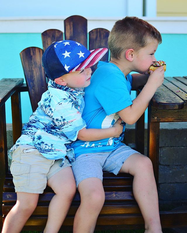 Recently these two have become the best of friends...UNLESS Lewis is trying to steal Teddy's food.  We found the cutest little donut shop during our road trip along 30A. Have you been? Each little beach town is cuter than the next, each with its own personality.  I would have been perfectly happy strolling through plazas and along the beaches, but we had to find a way to keep the kids' interest. Enter the donuts. And the grilled cheese (I mean, an entire food truck dedicated to grilled cheese in Seaside? Come on!) And the ice cream.  Sometimes you gotta bribe the kids with food on family trips. It's not ideal, but it's what works for us.  So what do you think...was this a genuine hug, or was he going in for the donut?  #exploreyourstate #familytravelblogger #exploringfamilies #amomexplores #takethekids #travelwithtoddler #findmeoutside #roadtripwithkids #roadtriplife #theeverymom #candidkids #floridamom #honestmommin #lifeasamama #tinybigadventure #sowal