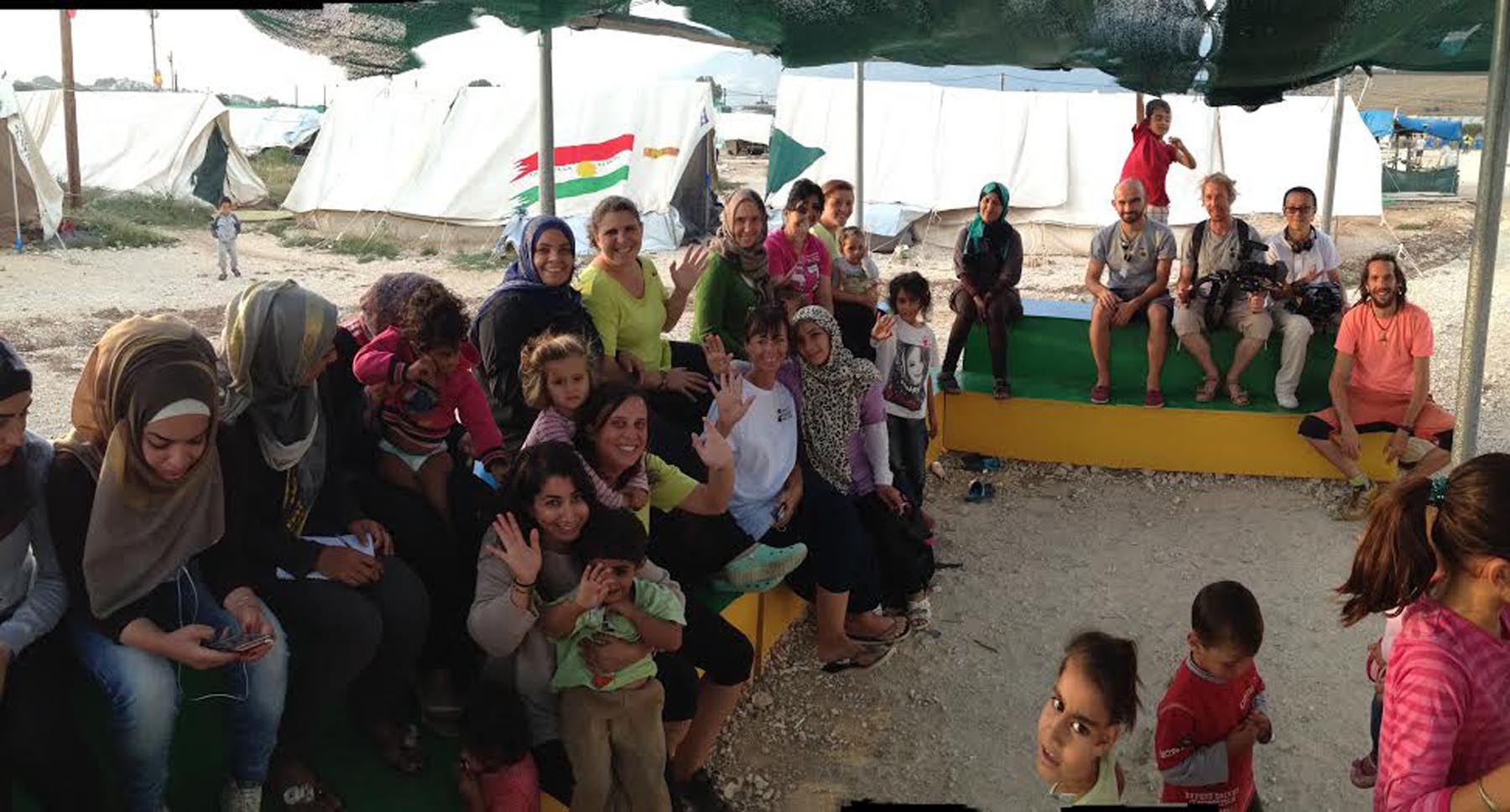 Refugees group together in a tent