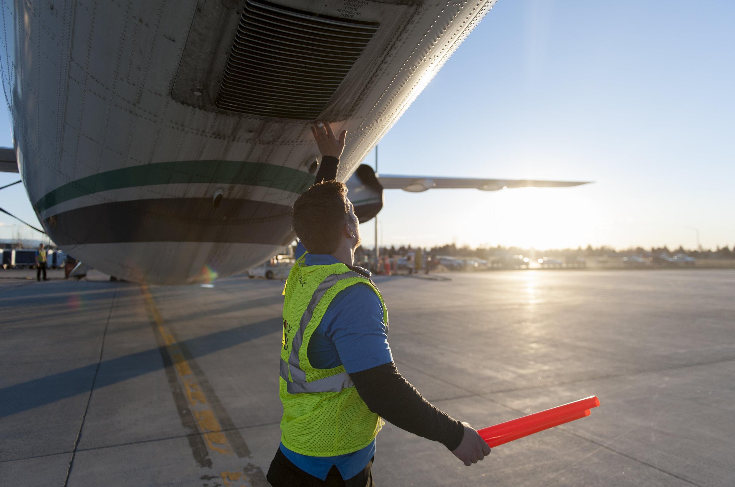 A ramp agent at Bozeman Yellowstone International Airport preforms a pre-flight walkaround on a flight bound for Seattle, Wash. Thursday, Mar. 23, 2017.