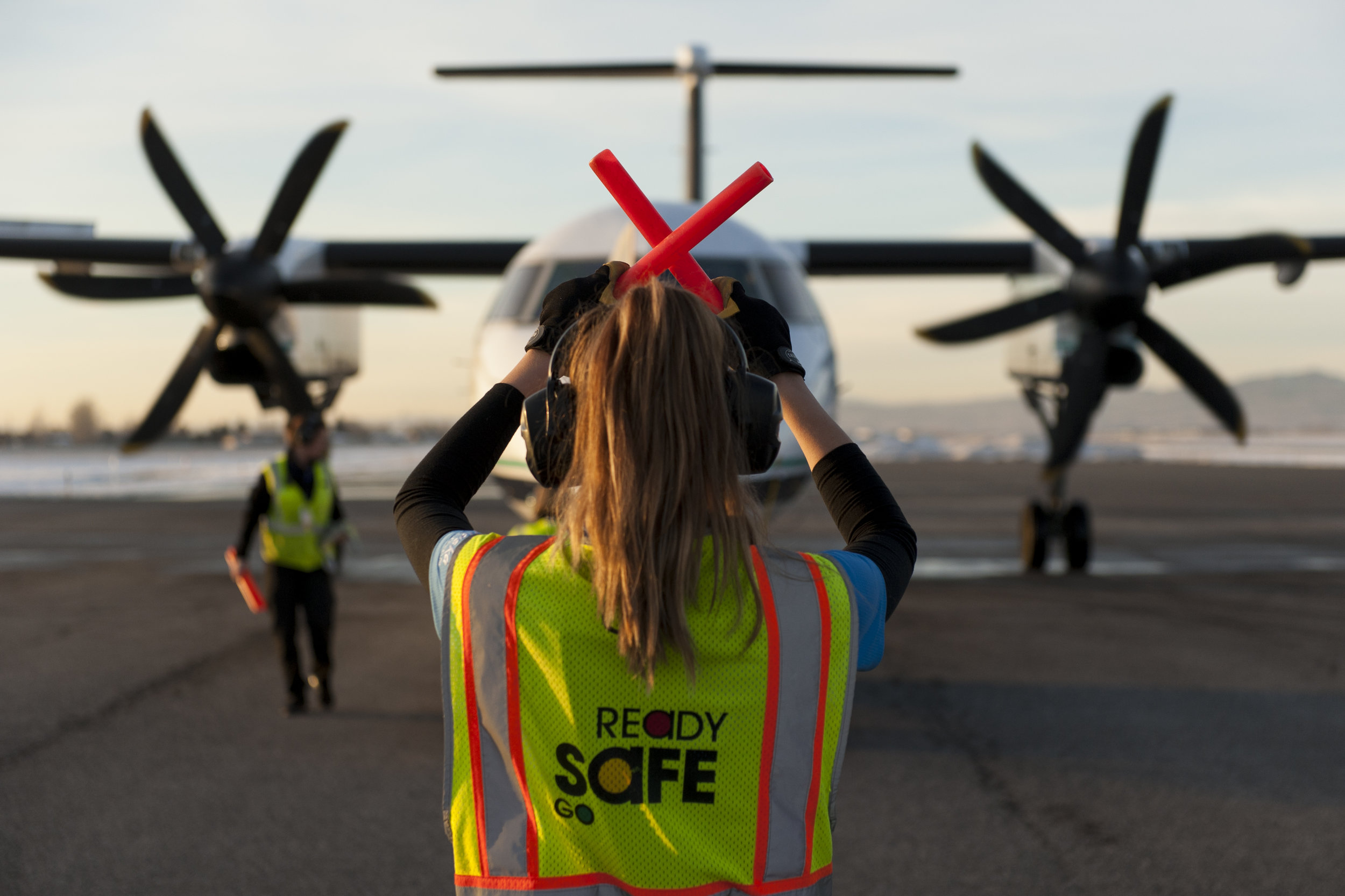 A plane bound for Seattle, Wash. is held for disconnect by a wing walker at Bozeman Yellowstone International Airport Sunday, Feb. 12, 2017.
