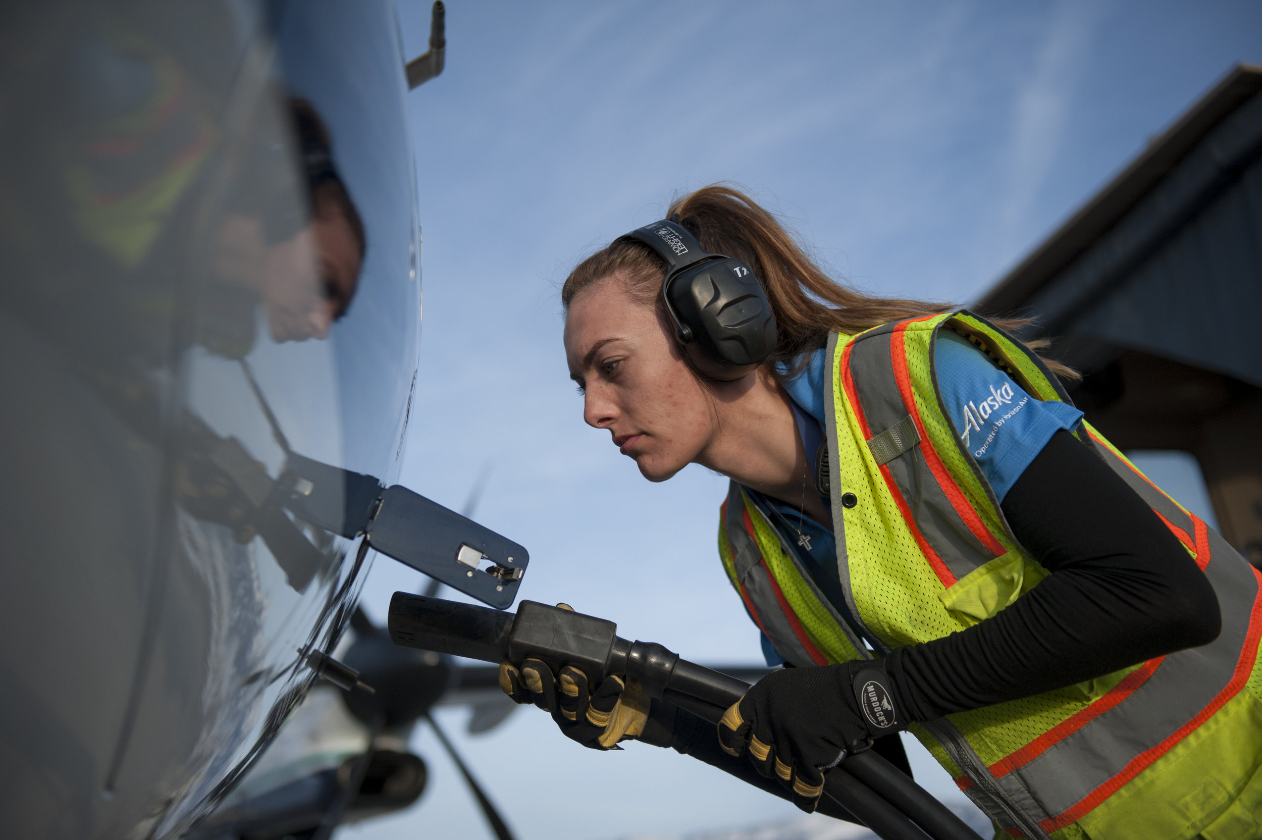 A ramp agent at Bozeman Yellowstone International Airport plugs the GPU cord into a Q400 aircraft Sunday, Feb. 12, 2017.