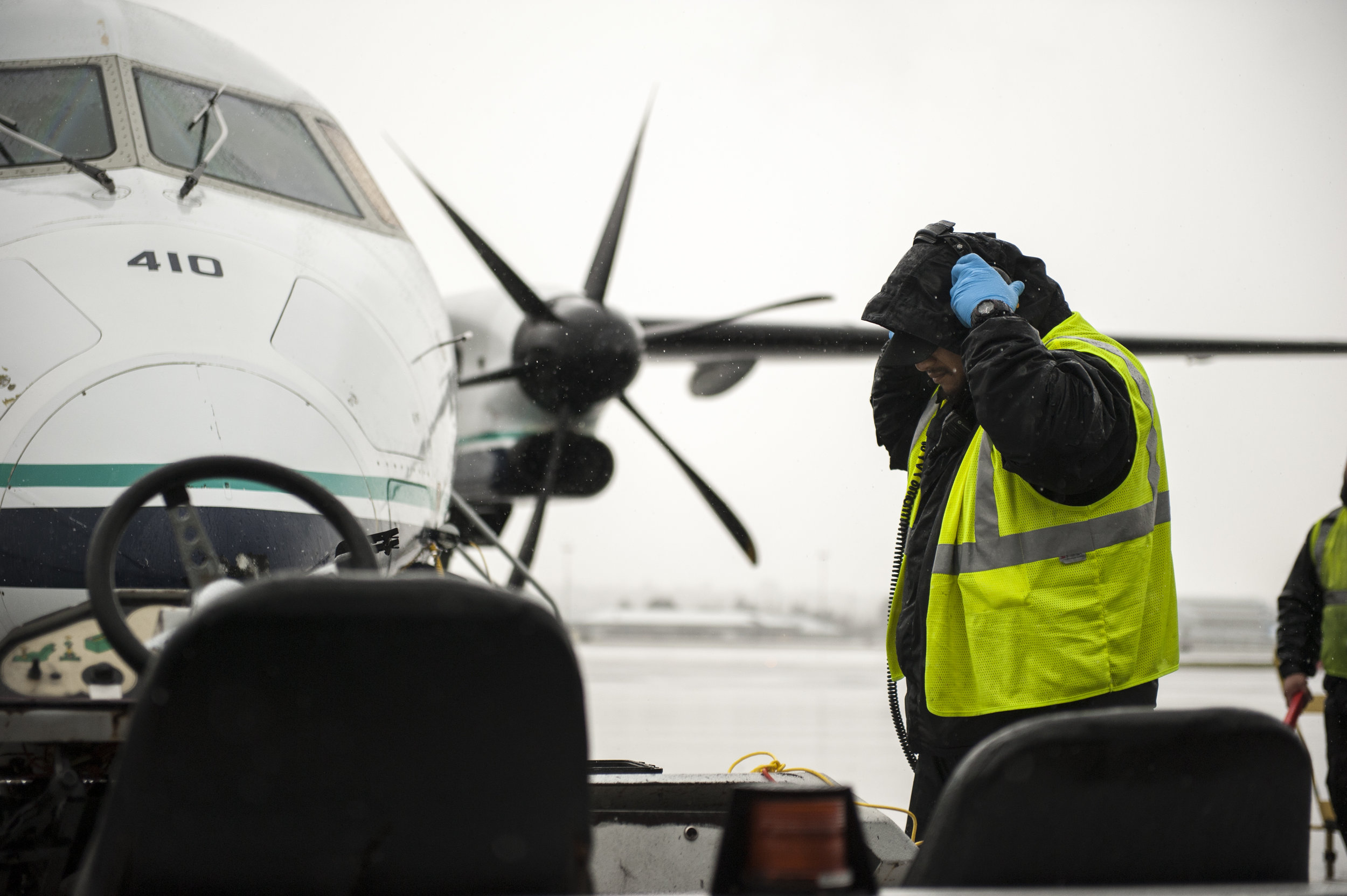 A ramp agent at Portland International Airport tests a communication headset prior to pushing back a flight Monday, Mar. 13, 2017.