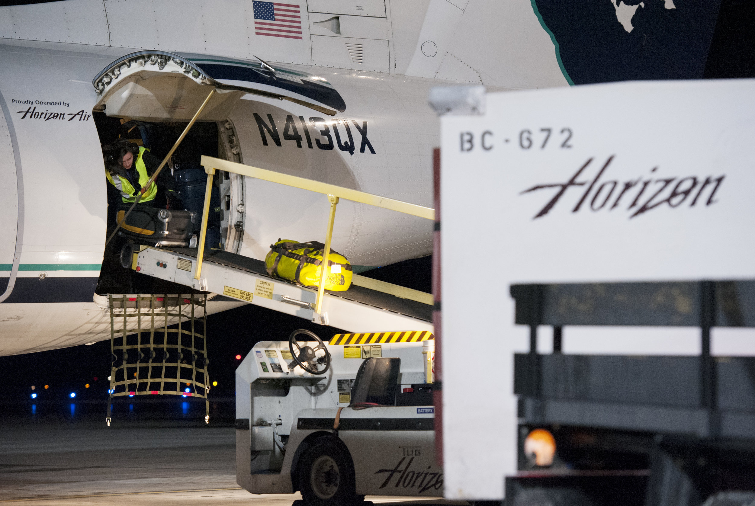 A ramp agent at Bozeman Yellowstone International Airport offloads baggage on a flight inbound from Seattle, Wash. Saturday, Jan. 28, 2017.