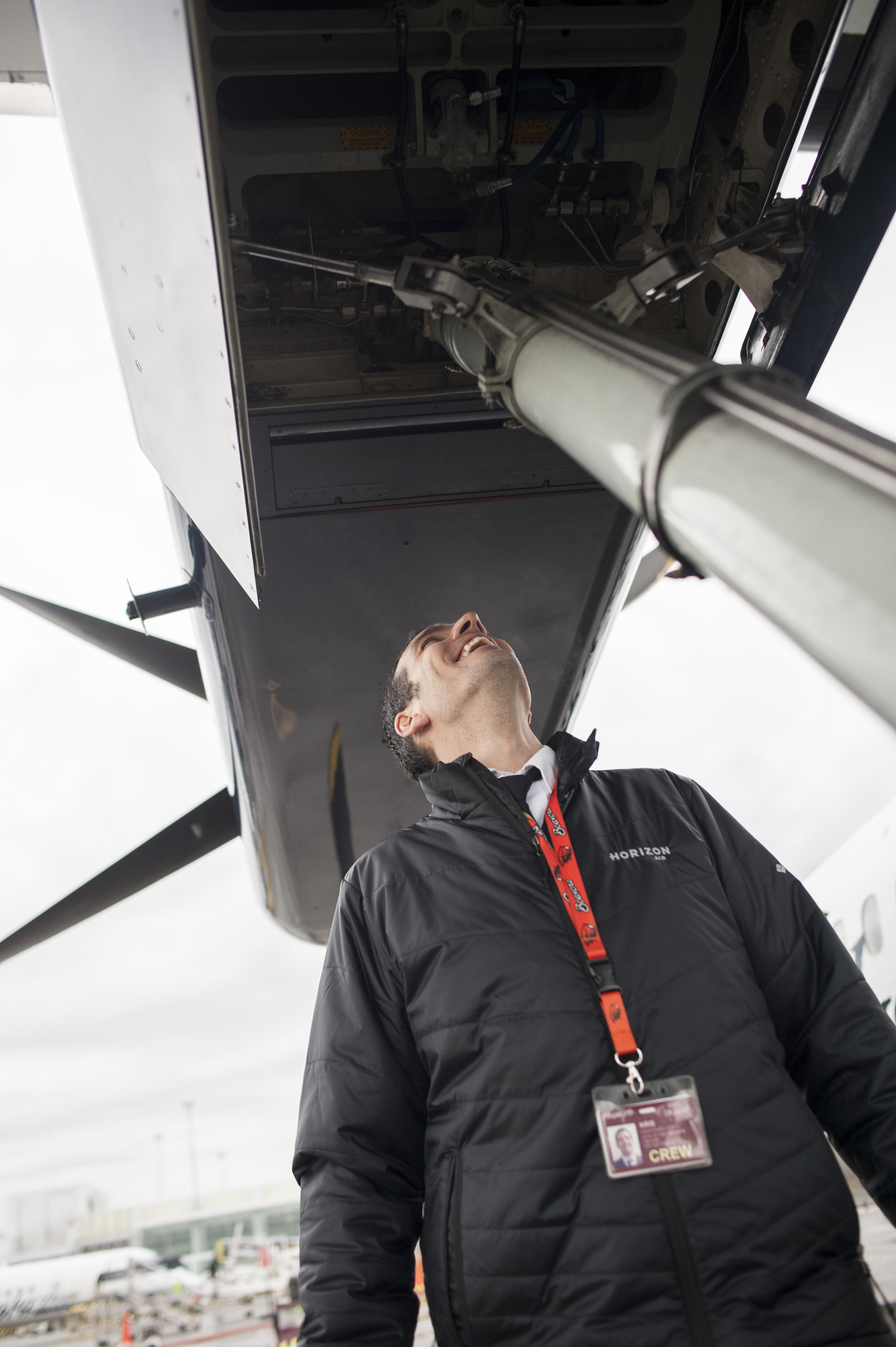 A Horizon Air pilot performs a post flight check of his airplane at Seattle - Tacoma International Airport on Tuesday, Mar. 21, 2017