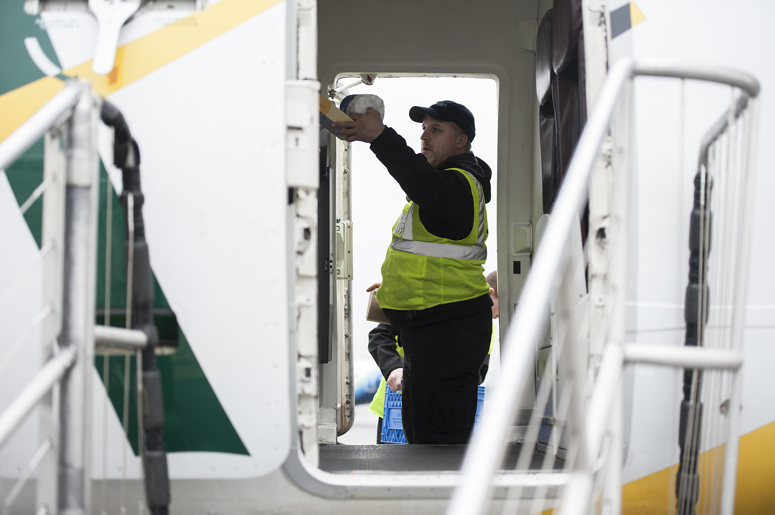 A food and beverage agent at Seattle - Tacoma International Airport restocks the galley of a Q400 prior to passenger boarding Tuesday, Mar. 21, 2017.