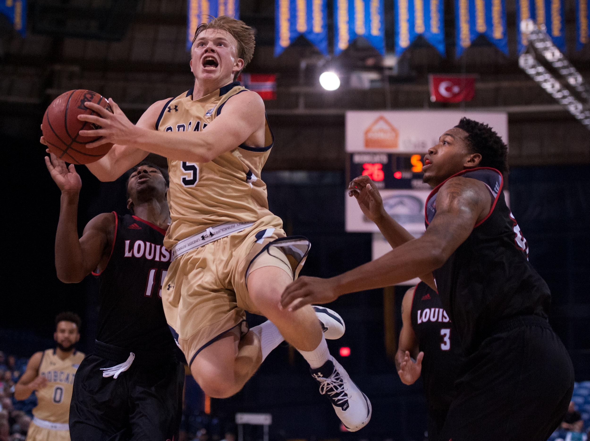 Montana State guard Harald Frey, center, flies past University of Louisiana Lafayette guard P.J. Hardy, left, and University of Louisiana Lafayette forward Bryce Washington, right, during the first half of an NCAA basketball game in Bozeman, Mont.  Sunday, Nov. 13, 2016