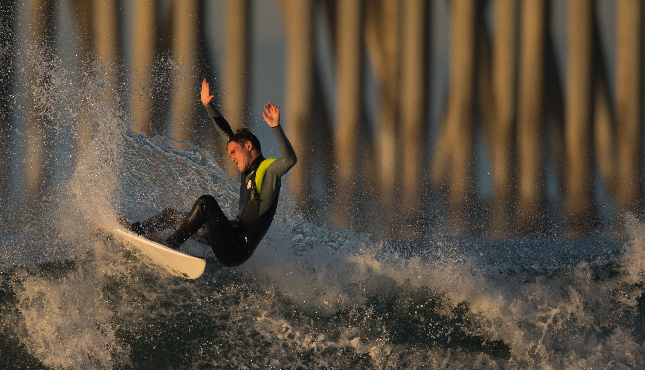A surfer catches a swell early in the morning Thursday, Nov. 03, 2016 at the Huntington Beach Pier in Huntington, CA.